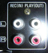 Input and output plugs on a cassette player